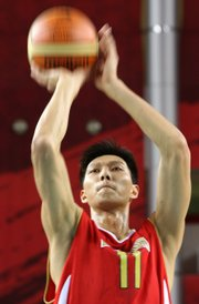 China's Yi Jianlian puts up a shot during the Asian Games in this file photo from Dec. 4, 2006, in Doha, Qatar. He'll become the NBA's fourth Chinese player, but it remains to be seen if he'll have the impact of the third, Yao Ming.