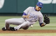 Kansas City shortstop Tony Pena tries to field an infield hit by Los Angeles' Orlando Cabrera. The Royals beat the Angels, 12-4, Tuesday in Anaheim, Calif.