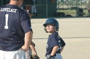 Mustangs runner Colton Lovelace looks up to his father, Colin, for baserunning advice.