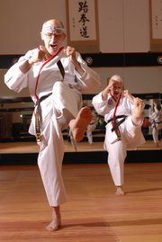 Bill Vermooten, left, and his wife Ginger, Lawrence, are 2007 world champions in Forms after a recent Tae Kwon Do competition.