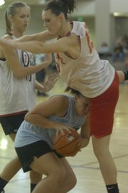Roxie Grizzle, a member of the Tonganoxie Unlimited Fitness basketball team, bottom, runs into a Ft. Osage defender during a game at the KU Student Recreation Center.