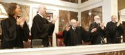 U.S. District Judge Wesley Brown, center, is applauded by his fellow jurists during his 100th birthday celebration Friday at the U.S. District Court in Wichita. Brown is the oldest federal judge in the nation still hearing cases. He was appointed by President John F. Kennedy in 1962.