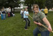 Mary McCullough, 12, competes in a game of tug-of-war Saturday during the Old Settlers Reunion in Oskaloosa.
