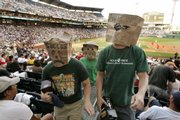 Adam Foust, left, and Tim Tomayko, right, of South Buffalo, N.Y., and Kris Kramer, center rear, of Sarver, Pa., participate in a walk out after the third inning of the Pirates' game against Washington. A small group of fans walked out of the game Saturday in Pittsburgh to protest the team's 15 years of futility.
