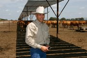 Jose Antonio Elias Calles is a veterinarian and president of HeartBrand Beef, the company that owns the herd of Akaushi breed of cattle in the background. The company has enough animals grazing in south Texas to market purebred American-raised Japanese beef to restaurants and consumers.