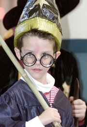 """Eric Lorentz, 6, of Indianapolis, waits his turn to take part in a Harry Potter costume contest at Glendale Mall in Indianapolis in this 2001 file photo. Harry Potter has become a modern phenomenon in the vein of """"Star Wars"""" and the Beatles. The books have sold 325 million copies."""