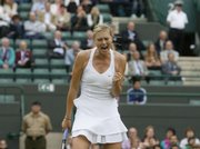 Maria Sharapova celebrates after defeating Japan's Ai Sugiyama, 6-3, 6-3, on a rainy Saturday at Wimbledon.