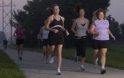 Runners participating in the EZ8 camp for women complete a morning run in this 2008 file photo. From left in foreground are Erin Parmelee, Rachel Combs and Elinor Brown. The EZ8 is an eight-week, outdoor running camp designed to help women of all fitness levels achieve their running goals.