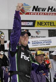 Nascar driver Denny Hamlin rejoices after winning the Lenox Industrial Tools 300 auto race on Sunday at New Hampshire International Speedway in Loudon, N.H.