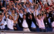England's Princes Harry and William, center front, enjoy the show with the rest of the crowd during a star-studded pop concert in memory of Diana, Princess of Wales, Sunday at Wembley Stadium in London. More than 63,000 people were at the stadium on what would have been Diana's 46th birthday.
