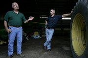 Roger Burtchin, 60, left, is seen with his son, Kevin, at Roger's farm near Pemberville, Ohio. Burtchin, a retired teacher, said he expects that one day his son, Kevin, will take over the farm. His son works as a civil engineer and raises hormone-free cattle in his spare time.