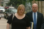 Meredith Kane, a former Lawrence High School teacher, walks to court in July with her attorney, James Rumsey in this Journal-World file photo.