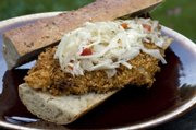 Topped with coleslaw in a baguette, Spicy Oven-Fried Catfish makes a great po'boy sandwich.