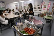 Teacher Leticia Jenkins instructs students about a healthy diet during her nutrition class June 6 at Vista Middle School in the Panorama City section of Los Angeles.