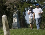 "Andrew Tash, left, cinematographer, and Ken Spurgeon, director, film behind-the-scenes footage in July for ""Bloody Dawn"" at Oak Hill Cemetery."