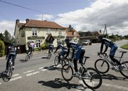 The Discovery Channel team rides in the countryside during a training session prior to the 94th edition of the Tour de France. The race starts today in London.