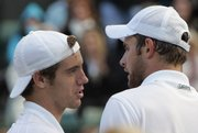 Richard Gasquet, left, greets Andy Roddick after beating him in a quarterfinal match. Gasquet won in five sets Friday at Wimbledon, England.