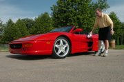 Chris Barteldes polishes his Ferrari in anticipation of this weekend's show in Lawrence.