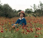Former first lady Lady Bird Johnson sits in a field of wildflowers in the Texas Hill Country in this May 10, 1990, file photo. Johnson, the widow of former President Lyndon B. Johnson, died Wednesday at her Austin, Texas, home. She was 94.