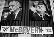 With the pictures of former Presidents Johnson and Kennedy behind him, Sen. George McGovern speaks at the Democratic National Committee on Aug. 9, 1972, in Washington. New material released by the Richard M. Nixon presidential library shows a keen interest in tainting the Democratic ticket of McGovern and Sargent Shriver by any means possible.