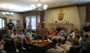 Incoming freshmen circle around for an introduction from Kappa Sigma members during a visit to the fraternity. The cost of greek living is comparable to KU residence hall room and board fees, making it affordable for interested students.