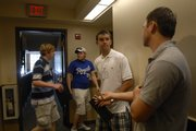 Mark Rigby, Marion, Iowa, freshman, second from right, talks with Kappa Sigma member and Paola junior Mike Thompson, right, as Overland Park freshman Jared Lindsay, left, gets a tour of the house from fraternity member and Prairie Village sophomore Derek Hoefer during a recent visit to the fraternity.
