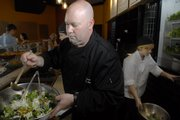 Steve Kerner, co-owner of Ingredient, prepares a Crispy Asian Salad on Friday at the new restaurant located at 10th and Mass.