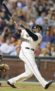Barry Bonds connects on career homer No. 600 in this file photo from Aug. 9, 2002.