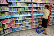 A Chinese woman looks at a wide selection of toothpastes Thursday at a Beijing mall. On Thursday, China banned manufacturers from using a thickening agent in antifreeze as an ingredient in toothpaste, one of its most significant concessions yet as it struggles to regain international confidence in the country's beleaguered exports.