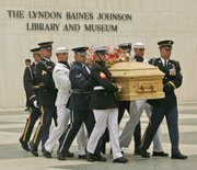 Armed services body bearers remove the casket of Lady Bird Johnson from the Lyndon Baines Johnson Library and Museum in Austin, Texas. Private funeral services for the former first lady were Saturday.