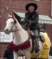 The Wild Women of the Frontier rode in Lawrence's Old-Fashioned Christmas Parade in 2005. The group will audition new members in October.