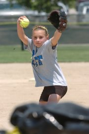 """Alex Beaird, 10, of the Tulsa Blast, displays her pitching talent during a skills competition. The skills contests Monday served as prelude to the American Fastpitch Association """"B"""" National Championships, which run today through Sunday."""