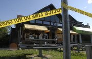 Police tape surrounds the former Yello Sub location at 624 W. 12th Street after a body was found at the location Monday morning. On Sunday night, a farewell party was held at the location, which stopped it's business on Saturday.