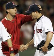 Boston Red Sox pitcher Josh Beckett, left, congratulates rookie Kason Gabbard after his complete-game, 4-0 victory over the Kansas City Royals. Gabbard blanked the Royals Monday in Boston.