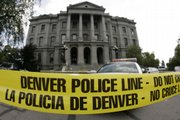 Police tape blocks the path to the Capitol in Denver on Monday after a suspect was shot when he apparently made threats against Gov. Bill Ritter.