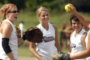 Tonganoxie Braves players, from left, Amie Riddle, Amanda Darrow and Sami Rush celebrate after making an out. The Braves defeated the Flames of Nebraska-Red Hot on Thursday at Youth Sports Inc.