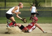 Tonganoxie Braves shortstop Amanda Darrow tags out Fort Scott baserunner Saturday during Tonganoxie's 3-0 loss at the AFA Fastpitch Nationals at Clinton Lake Softball Complex.