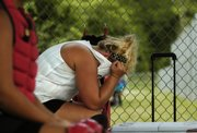 Ashlee Lohman of the Tonganoxie Braves is overcome with frustration Saturday as her team trails Scott Fort 3-0.