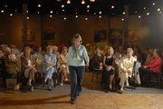 Lois Mead models new fashions during the Nantucket Tea and Fashion Show at Maceli's. The show and tea was sponsored by Douglas County Senior Services.