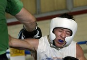 Geoff Benzing, left, and Justin Montgomery spar during boxing practice at Walt's Boxing.