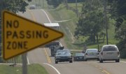 One mile west of Baldwin City, traffic flows on U.S. Highway 56 in a no passing zone. The Kansas Department of Transportation is planning to increase the speed on U.S. 56 from 55 mph to 60 mph in about a month.