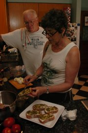 Neil and Leni Salkind work on an evening meal at their home. The Salkinds eat kosher foods and used to travel to Johnson County to buy kosher meats, but they can now purchase it at the Community Mercantile, 901 Iowa.