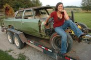 Kristy Wempe sits on her Demolition Derby car before the 2007 Douglas County Fair. This year will be the first time the derby will have a competition just for women — the Powderpuff Class.
