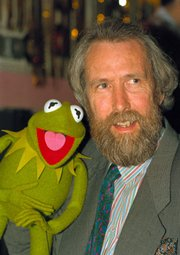 Jim Henson, creator of the Muppets, poses with one of his puppets, Kermit the Frog, in this February 1988 file photo. The Center for Puppetry Arts in Atlanta will receive everything from original puppets to sketches from Henson's personal collection, center officials and the Henson family announced Wednesday.