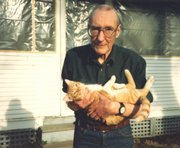 Burroughs with one of his cats