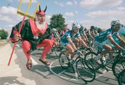 "Didi Senft, of Germany, also known as ""El Diablo,"" reacts as the pack passes the outskirts of Angouleme during Friday&squot;s 18th stage of the 94th Tour de France."