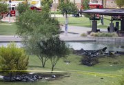 The wreckage of two news helicopters that collided over Phoenix are shown Friday. Two news helicopters covering a police chase on live television collided and crashed to the ground Friday, killing all four people onboard in a plunge that viewers saw as a jumble of spinning, broken images.