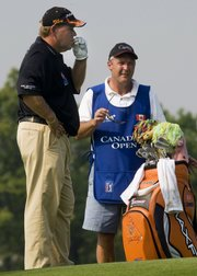 John Daly smokes a cigarette at the Canadian Open.