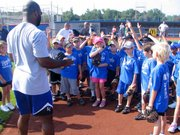 Former Kansas City Royals player Brian McRae ask participants about their infield experience. McRae was one of several former Royals who helped instruct the Royals Youth Clinic on Saturday at Arrocha Ballpark.