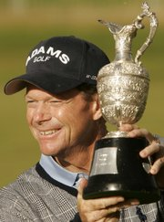 Kansas City's Tom Watson holds up the Senior British Open trophy after wrapping up the title on Sunday in Guillane, Scotland.